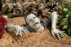 Zombie garden sculpture ==> http://www.lovedesigncreate.com/the-zombie-of-montclaire-moors-sculpture/ i kinda love this