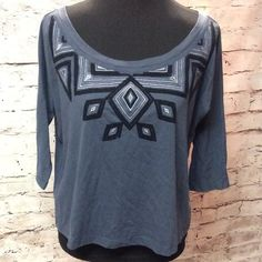 SZ LGAZTEC EMBROIDERED  PRINT SHORT TEE BY GAP Super cute and trendy short blouse with black embroidered aztec design.. 3/4 sleeves and super soft.. GAP Tops