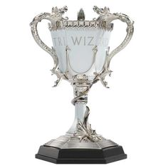 This is a stunning recreation of the Triwizard cup from Harry Potter and the Goblet of Fire. Made of die cast metal and fine pewter, it comes with wooden display base and measures approximately in height. Boutique Harry Potter, Harry Potter Shop, Harry Potter Wedding, Harry Potter World, Harry Potter Laden, Objet Harry Potter, Lord Voldemort, Harry Potter Enfants, Noble Collection Harry Potter