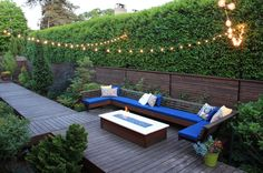Love the hanging light bunting.. How to Choose the Right Fence – 45 Delightfully Different Garden Walls and Fences | http://www.designrulz.com/design/2014/06/choose-right-fence-45-delightfully-different-garden-walls-fences/