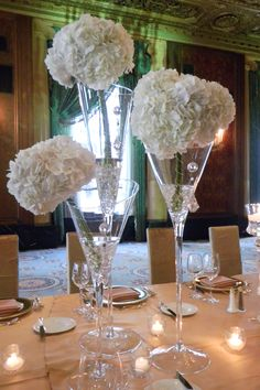 This striking and relatively inexpensive centerpiece with white hydrangea and hanging crystals would work for a variety of events! {love} | ELISAD.com