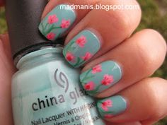 gorgeous! base of China Glaze For Audrey with freehanded sweetpeas in pink, white and red acrylic paint via @Amanda & Melissa Brown