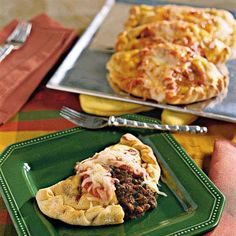Calzones with Italian Tomato Sauce  Make your own portable dinner pockets by stuffing refrigerated pizza crust with ground beef, cheese, spinach, tomato and Italian seasonings. This meaty pizza-inspired favorite is great for on-the-go meals, or a fun family night in.