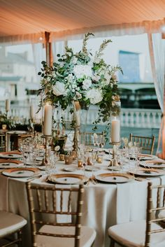Tall Centerpieces for the Round Tables at this tented Water Works Wedding. ::Florals by Beautiful Blooms :: Photography by M2 Photography ::