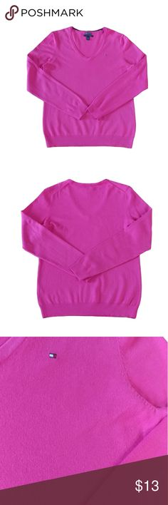 """Tommy Hilfiger Top Pink V-Neck Long Sleeve Cotton The vibrant hot pink and the comfy cotton feel of this Tommy Hilfiger top makes this V-neck the go-to choice for casual days!  Size:L Color:Pink Style Type:V-Neck Pullover Care:Machine washable Fabric:65% Cotton, 35% Nylon Measurements:Length 25.5"""", Pit-to-Pit 18.5"""", Waist 36"""" More Information:Pullover style. V-Neck. Long sleeves. Tommy Hilfiger logo on left chest. Hits at hips. In great condition! No snags, tears, or stains noted. From a pet…"""