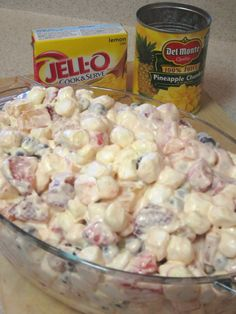 Lemon Delight Ambrosia ~ Delish summery twist on ambrosia made with fresh fruit w/a lemony twist! 32 oz. strawberries, 18 oz. blueberries, 2- 20 oz. cans pineapple chunks, 1 pkg lemon pudding, 8 oz. Cool Whip, 1/2-1 bag mini marshmallows. Mix pudding with 1/2 the juice from 1 can of pineapple then fold into Cool Whip. Mix fruit, Cool Whip mixture and marshmallows together in large serving dish. Chill until serving.