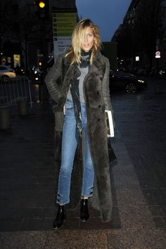 High waisted jeans, long coat. boots.