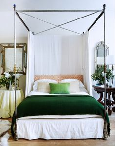 Rose Uniacke canopy bed with green blanket.