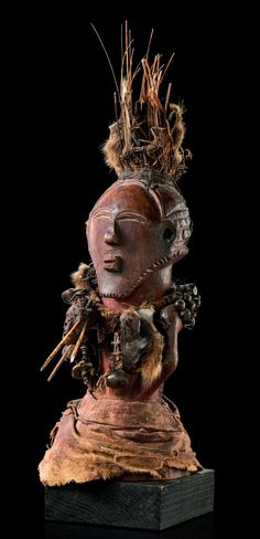"Africa   Power half figure ""kakudji"" from the Kusu people of DR Congo   Wood, fabric, animal vertebra, seeds, animal skin, metal"