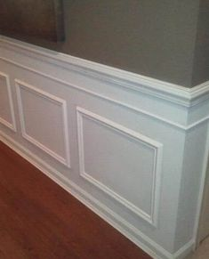 Faux wainscoting added to guilder's grade home. Add chair rail moulding and box moulding then paint to look like panel wainscoting.