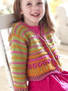 Free Pattern - Little girls look absolutely darling in the cardigan, #knit with colorful stripes and bobble-topped flowers!