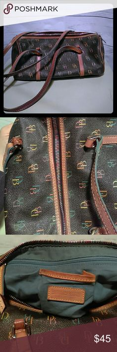 "🌈Dooney & Bourke Barrel Purse w/Rainbow Zipper 🌈 Formerly Loved, all flaws shown in pic - the leather that attaches one of the straps to the bag is scratched but fully intact. One of the zippered pouches inside the bag is missing the leather pull, but the zipper works fine. This is an authentic D&B bag, genuine leather, the lining inside has a few minor stains from use -but will likely clean out. Includes a leather strap with keychain. 11""wide by 7"" deep; strap has a 7"" drop S/N I2 170160…"