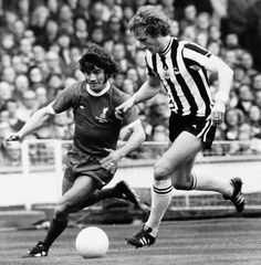 Kevin Keegan of Liverpool beats Pat Howard of Newcastle in the 1974 FA Cup Final