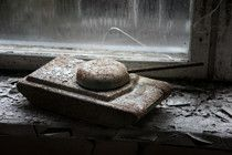 A childs toy tank left on a window ledge in an elementary school Untouched for decades now Chernobyl Ukraine - Photorator