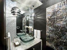 Super white granite creates a waterfall vanity in the powder room, where silver mosaic tile clads the backsplash and glass globe pendants illuminate the space.  #HGTVUrbanOasis  http://www.hgtv.com/urban-oasis/hgtv-urban-oasis-2013-foyer-pictures/pictures/page-4.html?soc=pinterest