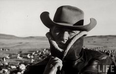 1960– Cowboys on long cattle-drive from South Dakota to Nebraska.  –photo by Grey Villet