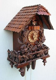 Romba Chalet Cuckoo Clock with deep carved Grape leaves, birds and dancers, Model #8347     Beautiful, three-dimensional carvings adorn this charming chalet cuckoo clock with animated bird and dancers. There is a lot of clock here for the price. The large chalet features leaves, vines, grapes and three-dimensional birds.