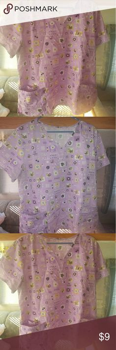"""Cute """"Bee Happy, Be Well, Be Healthy"""" Scrub Top This adorable scrub top is a 2X/3X officially but fits more like a 2X. Has no stretch really. In great used condition. Only flaws I could find are pictured (some loose/free hanging thread that can be cut with no damage to the top & some darkening/discoloration around the armpit area from deodorant use). It has an extra pocket inside one of the larger pockets. The top is a light purple/lavender and has bees, flowers, hearts, ladybugs, colored…"""
