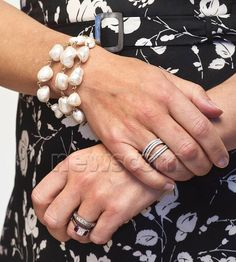 Princess Mary of Denmark (from Prince Frederick). Baroque pearl bracelet and multicolor gold stacked rings.