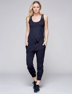 FINAL SALE We would wear our jumpsuit for a walk along any of our favorite beaches. Perfect paired with sneaks and sunnies. Drawstring at waist for adjustability Honeycomb mesh detail 88% Promodal 12%