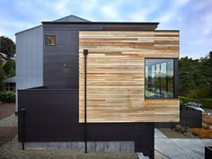"""""""So we wanted to choose where the nicer materials were, then let some of the building be background materials."""" For example, the exterior is mostly cost-conscious fiber cement siding painted black, which recedes into the background to let the cedar-sided box become more prominent. """"It was about creating a hierarchy of materials,"""" Chadbourne says."""