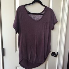 Free People berry Vneck Sz M Worn once and handwashed, hung to dry. Perfect condition. A simple berry colored Vneck tshirt from Free People. I typically buy an XS, S in FP, but bought a medium in this because it fits tighter than most of their items. The M gives it an oversized fit & makes it not a tight fitting tshirt. It's great for every day wear and a perfect shirt to pull on for any event. Free People Tops