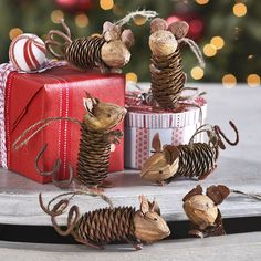 Who knew a pinecone could turn into something so cute? These mice are all handmade from pinecones, bark, and nutshells. Each is tied with a jute string to hang from a tree or present but could make a fun addition to a tabletop spread. Wisteria.com