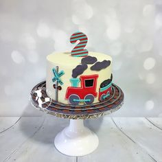 Train themed cake to match the birthday boy's shirt. #train #travel #cake #birthday #birthdaycake #second #two #buttercreamcake