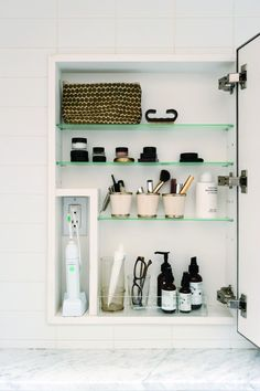 Julie Carlson's custom medicine cabinet with built-in electric toothbrush niche | Remodelista
