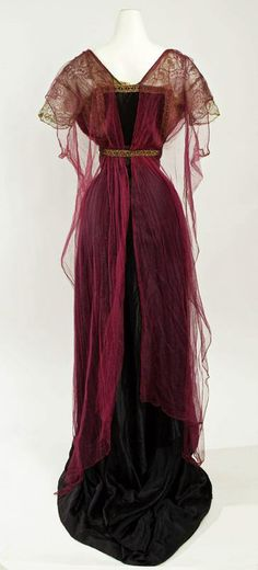 Callot Soeurs, evening dress in burgundy (?) and black with old gold trim and lace sleeves, 1911, rear view. Photo: Metropolitan Museum of Art.