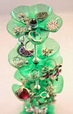 Make this wonderful recycled plastic bottle jewelry stand with a metal stand, bottle cut outs, and basic crafting supplies.