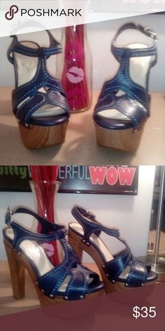 Platform heels A very groovy stitch detailed platform sandal with a wooden heel.Wear with a pair of skinny jeans or a nice sun dress.worn once,but can't tell. Jessica Simpson Shoes Platforms