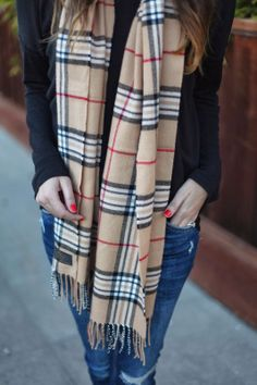 Add a printed scarf to a simple outfit.