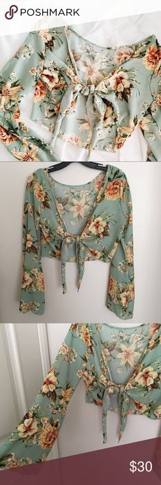 Floral Tie Top Giving you the boho videos with this floral flare sleeve top that ties in the front. (Armpit area run a little small) mint color mikey & joey Tops