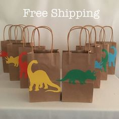 Items similar to 12 Dinosaur Brachiosaurus & Triceratops Party Bags Loot Goodie Totes on Etsy - 12 Dinosaur Brachiosaurus & Triceratops Party Bags Loot Goodie Source by olesja_kern 3rd Birthday Party For Boy, Dinosaur First Birthday, Dinosaur Party Decorations, Birthday Party Decorations, Die Dinos Baby, Party Bags, Etsy Shop, 1, Ideas