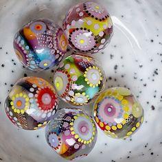 Melanie Moertel: hand blown Kaleidoscope glass beads. Each is a one of a kind!