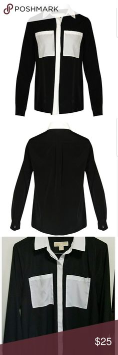 MICHAEL Michael Kors black longsleeve blouse MICHAEL Michael Kors blouse in excellent used condition!  Black polyester blouse with long sleeves and white lining, collar, and pockets. The hidden buttons down the front make it super chic!  Loose flattering fit that's perfect for the office, casual wear, or even going out tucked into a skirt with cute heels!  Size medium, retails for $70 MICHAEL Michael Kors Tops Tees - Long Sleeve