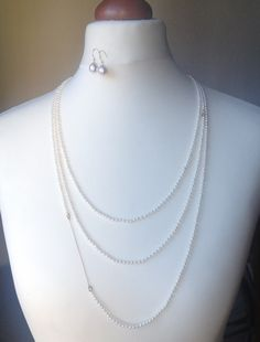 Seed pearl necklace w/ white pearl and gold earrings from mariliissepper.com