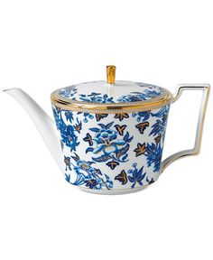 Wedgwood Hibiscus Teapot  .... blue and gold floral botanical pattern on white body, 22-karat gold knob and edging on rim and handle, 2015, fine bone china, UK