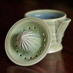 Citrus juicer with storage jar. This is the third post of the finished citrus juicers. It juices nicely, pours well, looks good, the only problem I am having with this is in the firing. The two pieces are fired separately because I want the rim glazed so