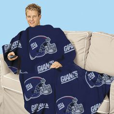 "Product #HC9951 - NFL blanket with sleeves keeps you toasty-warm while rooting for your favorite gridiron team! Cozy, roomy fleece blanket with sleeves covers you from head to toe. Lets you move freely to stretch, cheer or grab snacks! Great for watching TV, going to games, or relaxing. One size fits all. Washable poly/fleece. 48""W x 71""L   $29.98"