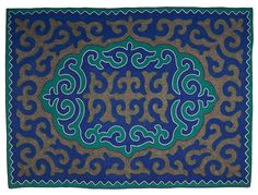 Mediun sized tri-colour shyrdak felt rug from Felt combining all-natural, un-dyed, grey wool felt, with an emerald green and a cobalt blue coloured wool felt, and braiding in white, brown and green coloured wool 1.5m x 2.05m feltrugs.co.uk