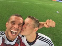Podolski and Schweinsteiger after the final