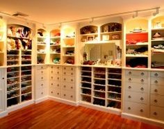 White Closet. Large Male and Female. Some good Ideas. Varied Layout. L Shaped. No hanging space shown.