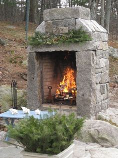 -CD Custom natural wood outdoor fireplace built with a mix of reclaimed curbing and granite blocks. Diy Fire Pit, Fire Pit Backyard, Backyard Patio, Backyard Landscaping, Fire Pits, Outside Fireplace, Backyard Fireplace, Outdoor Fireplaces, Rumford Fireplace
