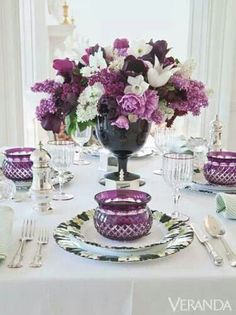 Centerpiece of lilacs and tulips!!! Bebe'!!! Love this lilac and purple tablescape!!!