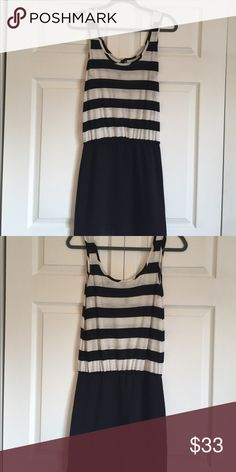 Black and white striped dress Black and white striped dress! It looks like a tight black body skirt with a tank top when worn!! Adorable and in great condition. Super comfortable and easy to wear! Dresses Mini