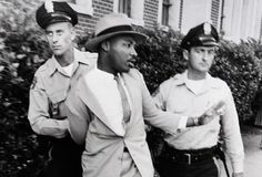 Martin Luther King Jr. being arrested by two white police officers in Montgomery Alabama on September 4, 1958.