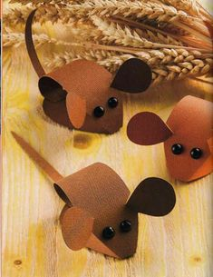 cute easy to make harvest mice great for kids , preschool , nursery craft activity or for making to decorate a festival display .