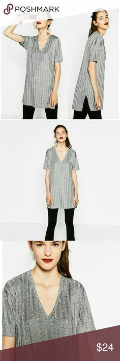 Zara Silver Grey Ribbed V Neck Top Authentic Zara Shiny Ribbed Tunic in Grey. 96% Polyester,  4% Elastane. 31 inches from shoulder to front hem and back is slightly longer at 34 inches long. Modern style with side slits. Brand new with tags// Size M. Zara  Tops Tunics
